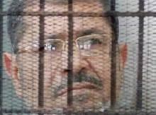 مرسي خلف القضبان